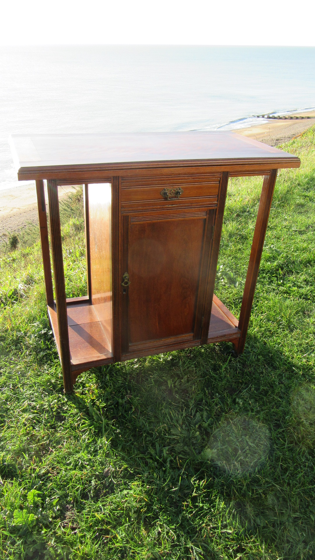 ANTIQUE WALNUT SWIVEL TOP GAMES TABLE