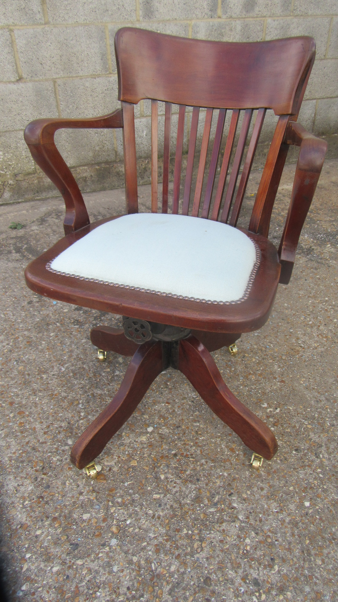 ANTIQUE RECLINING OFFICE SWIVEL CHAIR