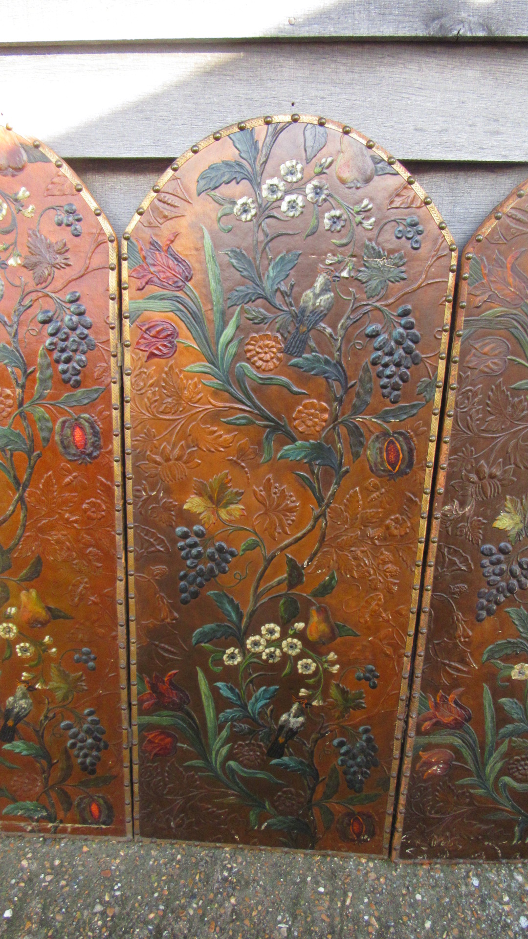 DECORATIVE ANTIQUE PAINTED EMBOSSED LEATHER THREE FOLD SCREEN