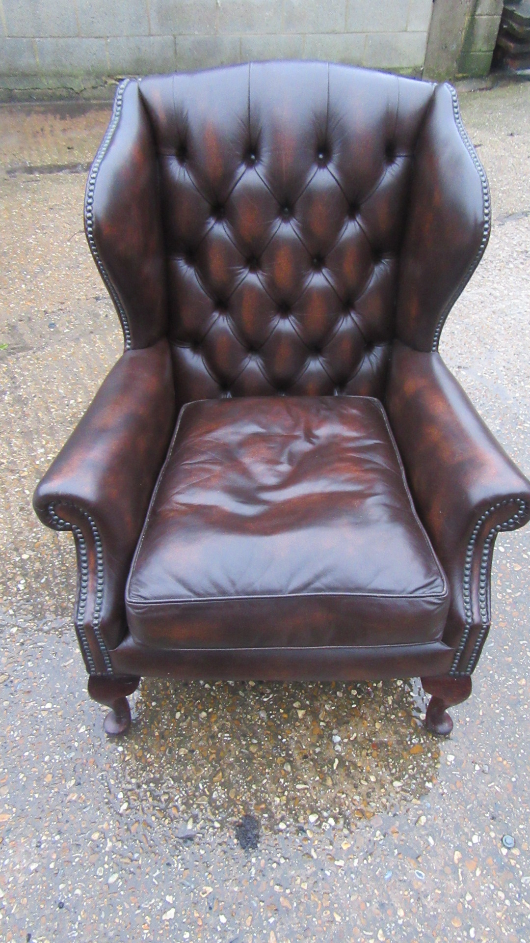 ANTIQUE STYLE DEEP BUTTONED LEATHER WING ARMCHAIR